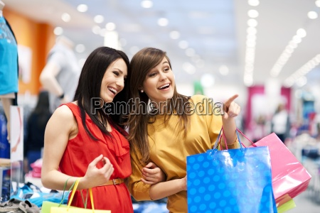 two girlfriends with shopping bags