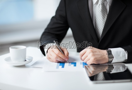 man with tablet pc and cup