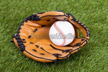 leather glove with baseball ball