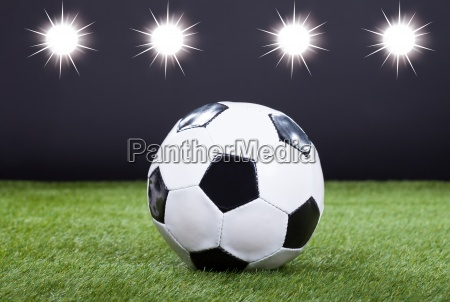 soccer ball on green pitch