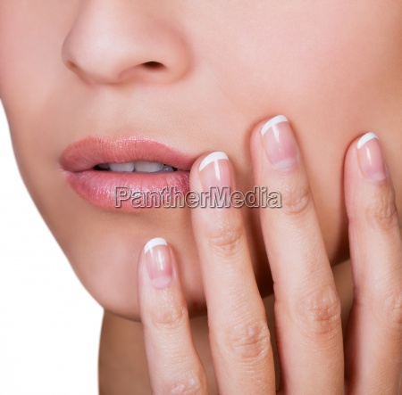 woman with beautiful manicured finger nails