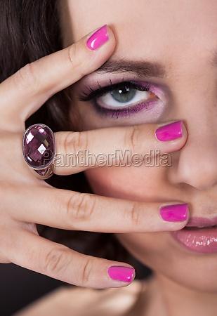 young woman with pink nail varnish