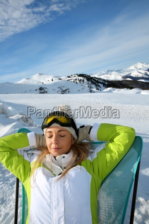 woman in ski outfit relaxing in