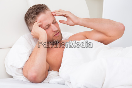 man waking up with a nasty