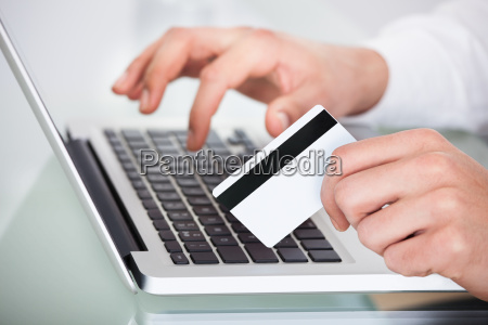 man shopping with credit card and