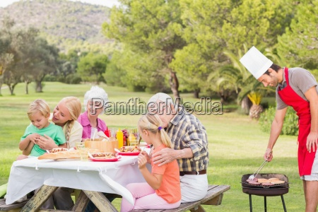 multi generation family enjoying a barbeque