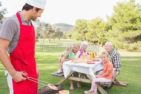 family sitting at picnic table waiting