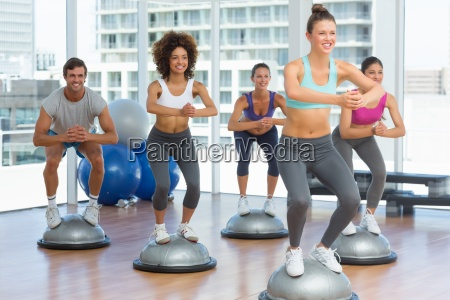 fitness class and instructor doing pilates