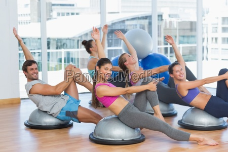 sporty people stretching hands at yoga