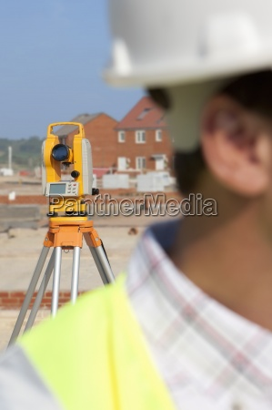close up of surveyor with theodolite