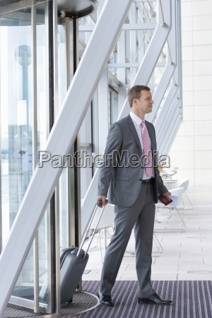 businessman with passport and suitcase arriving