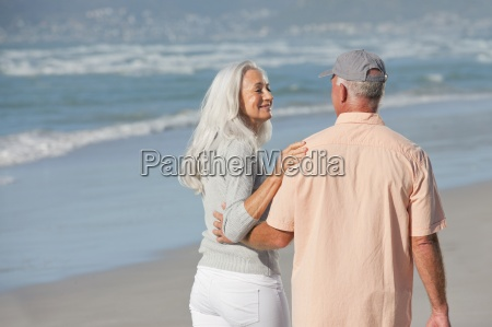 senior couple hugging and walking on