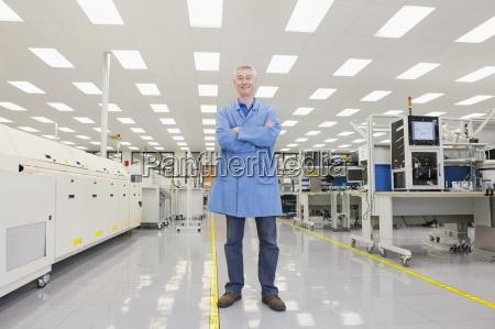 portrait of smiling engineer in hi