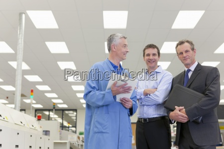 portrait of smiling engineer and businessmen