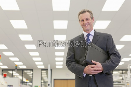 portrait of smiling businessman in hi