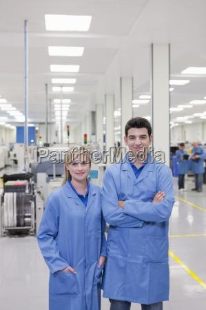 portrait of smiling technicians in lab