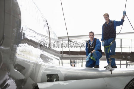 portrait of engineers on wing of
