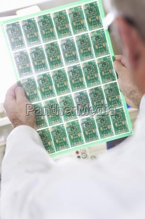 close up of engineer examining printed