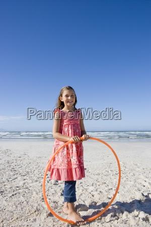 girl 5 7 with plastic hoop