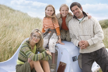 portrait of young family sitting in