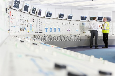 engineers at control panel in control