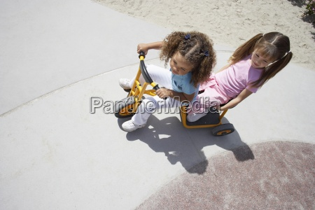 two girls 4 6 riding toy