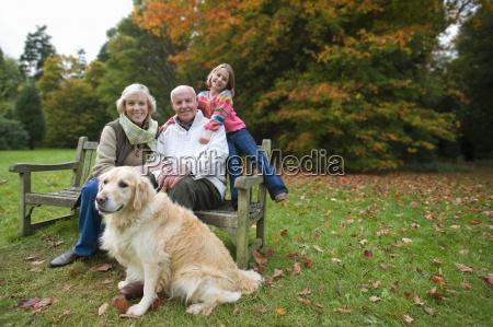 portrait of grandparents granddaughter and dog