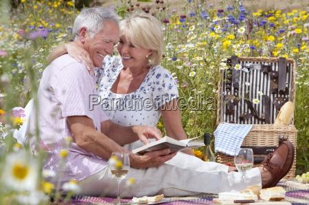 senior couple drinking wine and having