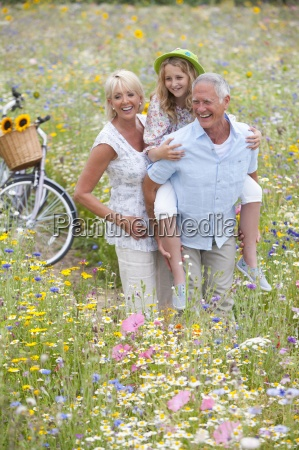 senior couple standing in field of