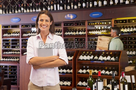 smiling business owner with digital tablet