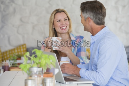 couple drinking coffee together at table