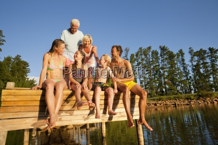 multi generation family sitting on wooden