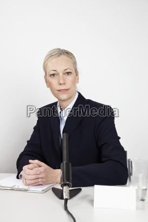 woman women interview presentation desk colour