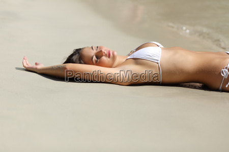 sunbather woman showing laser hair removal