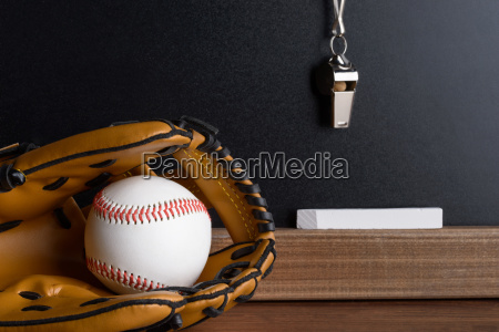 whistle chalk and baseball glove with