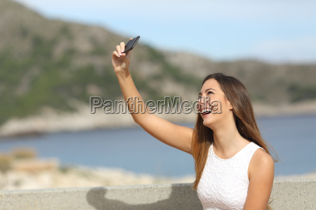 happy girl photographing a selfie on