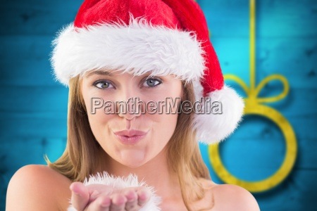 composite image of festive blonde blowing