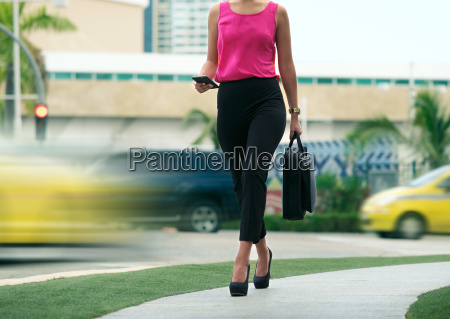 business woman female commuter going to