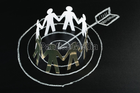 white paper cut out figures over