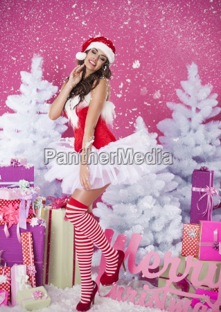 sexy brunette woman in santa claus