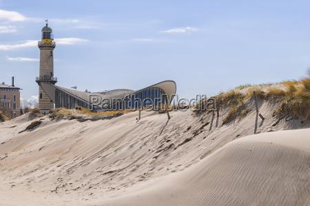lighthouse warnemunde sand dune