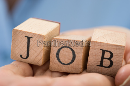 person hand with the word job