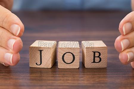 person hand saving the word job