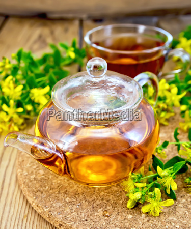 tea from tutsan in glass teapot