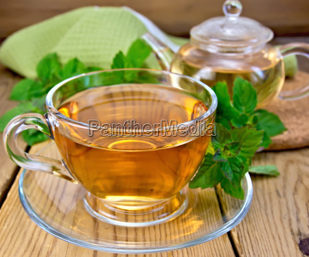 tea with mint and napkin on