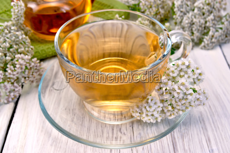 tea with yarrow in glass cup