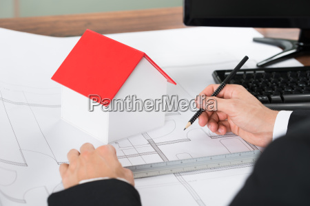 close up of architect making blueprint