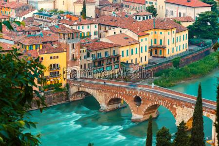 ponte pietra and adige at night