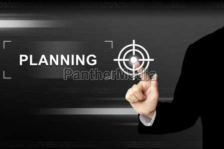 business hand pushing planning button on