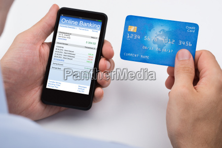 person with credit card and mobile